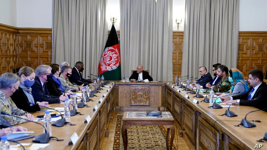 Afgan President Ashraf Ghani, center, meets with U.S. Defense Secretary Lloyd Austin, center left, and their delegations, at the presidential palace in Kabul, Afghanistan, March 21, 2021.