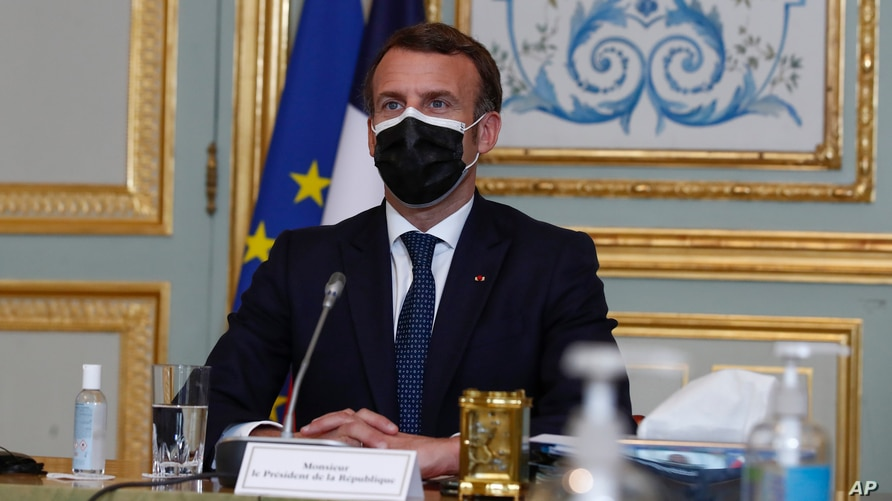 French President Emmanuel Macron attends a video conference of a EU summit at the Elysee Palace in Paris, March 25, 2021.