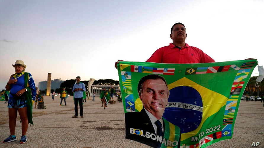 Demonstrators pray in support of Brazil's President Jair Bolsonaro in front of the Planalto presidential palace, in Brasilia,…