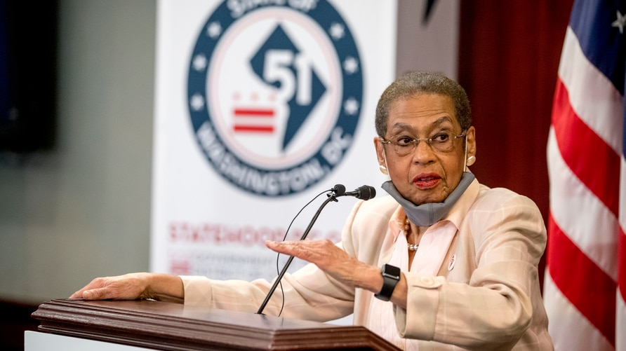 Delegate Eleanor Holmes Norton, D-D.C., speaks at a news conference on District of Columbia statehood. Behind her is a logo.