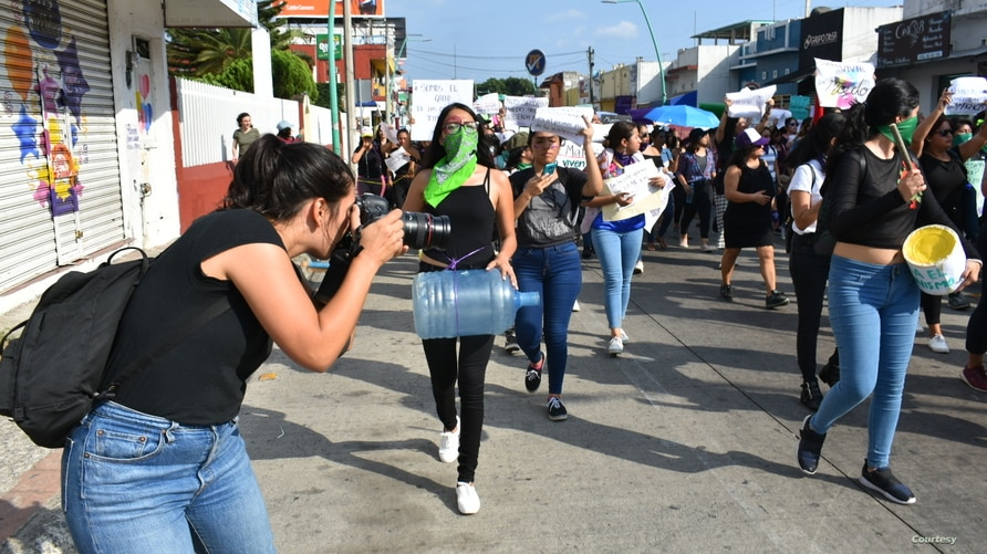 Journalists cover an International Women's Day protest in Tapachula, Mexico. A joint partnership is offering training and support to women in media and politics in Mexico, Kenya and Sri Lanka. (Courtesy - IWMF)