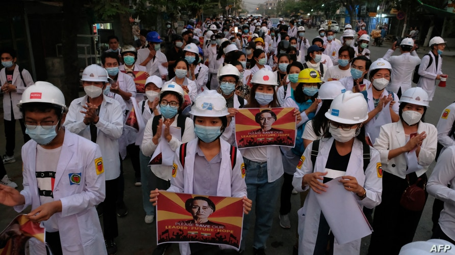 Medical staff and students take part in an early morning protest against the military coup and crackdown by security forces on demonstrations in Mandalay, Myanmar, March 21, 2021.