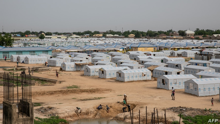FILE - A tent city for people internally displaced by Boko Haram violence is seen at the unfinished Mohammed Goni Stadium in Maiduguri, Nigeria, July 26, 2019.