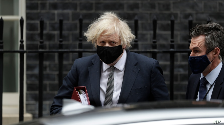 FILE - British Prime Minister Boris Johnson leaves 10 Downing Street to attend the weekly Prime Minister's Questions at the Houses of Parliament, in London, March 24, 2021.
