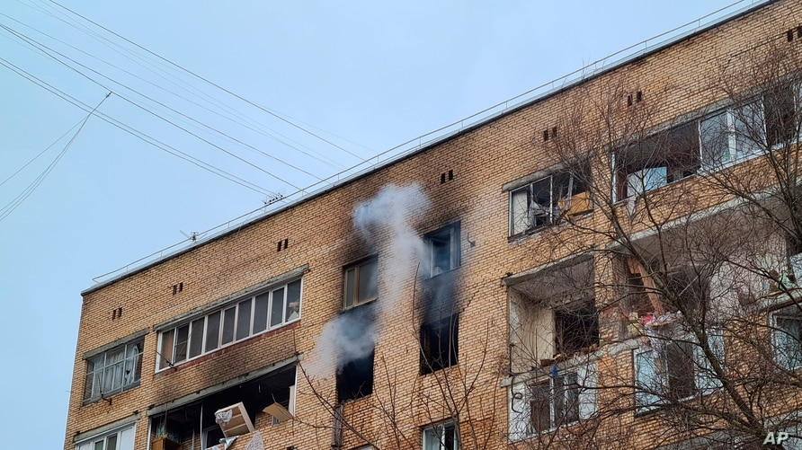 Smoke pours from an apartment building after a suspected gas explosion, in Khimki, outside Moscow, Russia, March 19, 2021.