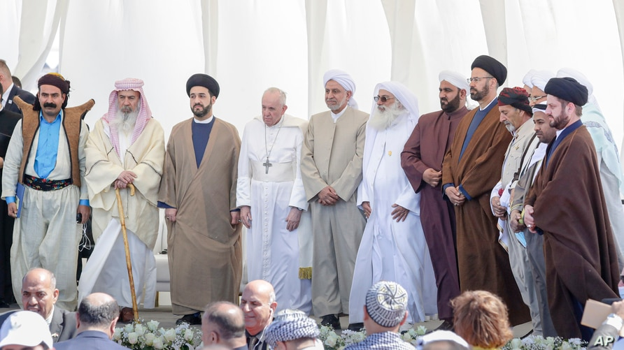 Pope Francis stands with religious leaders during an inter-faith meeting near the historic city of Ur, near Nasiriyah, Iraq, March 6, 2021.
