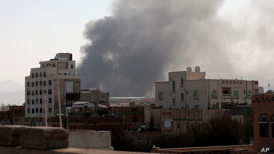 FILE - Smoke rises after Saudi-led coalition airstrikes on a target in Sanaa, Yemen, March 7, 2021. The coalition has launched a new air campaign on the war-torn country's capital and on other provinces.