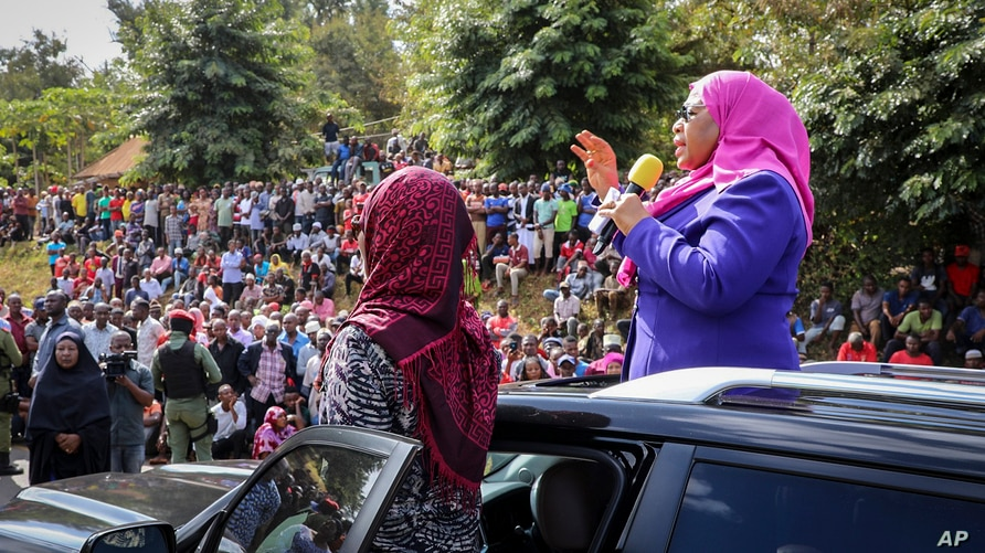 Tanzanian Vice President Samia Suluhu Hassan, right, speaks during a tour of the Tanga region of Tanzania, March 16, 2021.