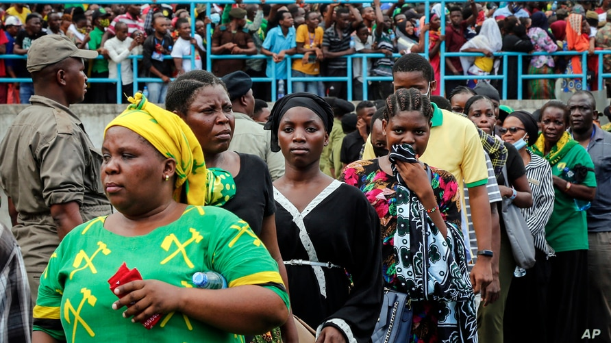 Mourners queue to pay their respects as the body of former President John Magufuli lies in state at Uhuru stadium in Dar es Salaam, Tanzania, March 20, 2021.