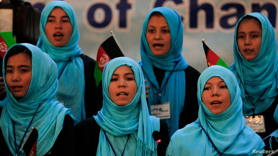 FILE - Girls sing the Afghan national anthem at an event in Kabul, Afghanistan, Sept. 26, 2013.