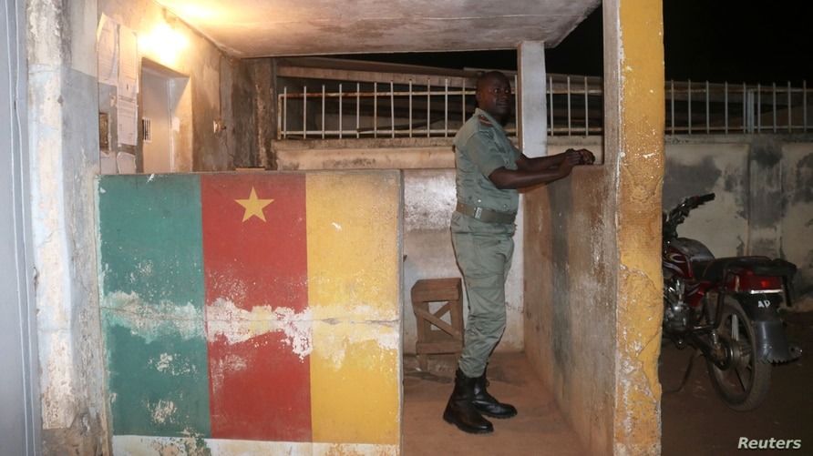 FILE - A security officer stands in guard at a prison in Yaounde,Cameroon, Sept. 1, 2017. Overcrowded prisons in the country are said to have become hotbeds for the coronavirus.