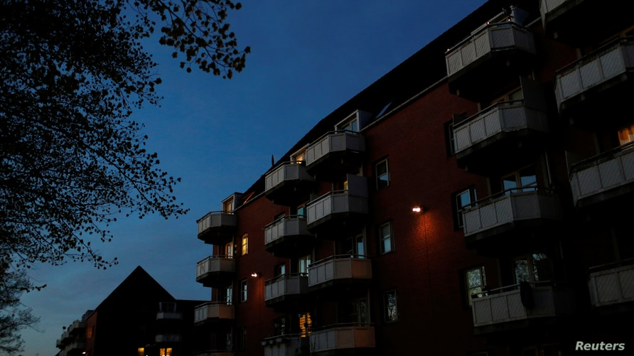 """FILE - Night falls over Mjolnerparken, a housing estate for migrants that features on the Danish government's """"Ghetto List,"""" in Copenhagen, Denmark, May 2, 2018."""