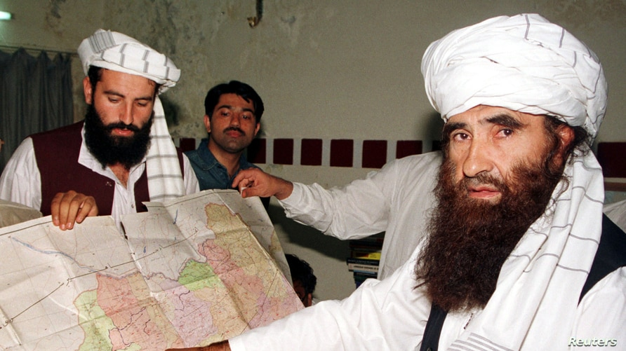 FILE - Jalaluddin Haqqani, right, founder of the Haqqani network, is seen during a visit to Islamabad, Pakistan, Oct. 19, 2001. A speech by one of his sons, Sirajuddin Haqqani, who now heads the network, is drawing renewed attention.