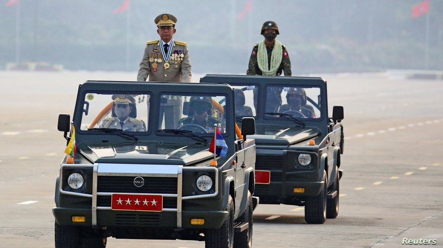 Myanmar's junta leader General Min Aung Hlaing, who ousted the country's elected government in a Feb. 1 coup, presides an army parade on Armed Forces Day in Naypyitaw, Myanmar, March 27, 2021.