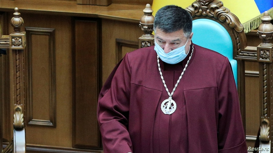 FILE - Oleksandr Tupytskyi, head of the Constitutional Court of Ukraine, presides over a court session in Kyiv, Ukraine, June 23, 2020.