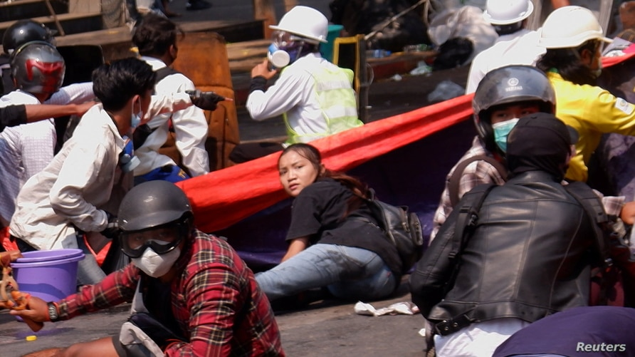 Angel a 19-year-old protester, also known as Kyal Sin, lies on the ground before she was shot in the head as Myanmar's forces opened fire to disperse an anti-coup demonstration in Mandalay, March 3, 2021.