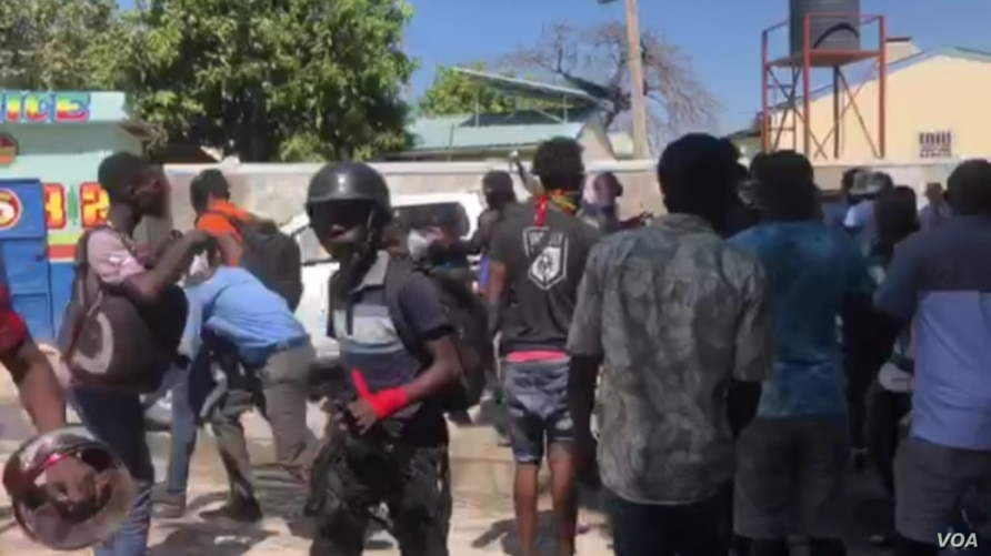 Fantom 509 renegade officers and their supporters exit Croix des Bouquets police station after freeing a colleague from jail, March 18, 2021.