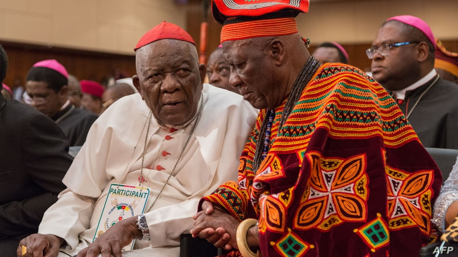 Cardinal Christian Wiyghan Tumi (L) talks with Cameroonian veteran opposition leader John Fru Ndi as they attends at the…