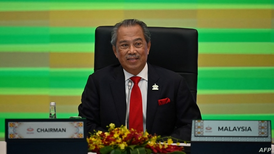 Malaysia's Prime Minister Muhyiddin Yassin takes part in the online Asia-Pacific Economic Cooperation (APEC) leaders' summit in…