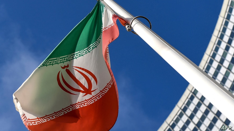 The Iranian national flag is seen outside the International Atomic Energy Agency (IAEA) headquarters during the agency's Board…