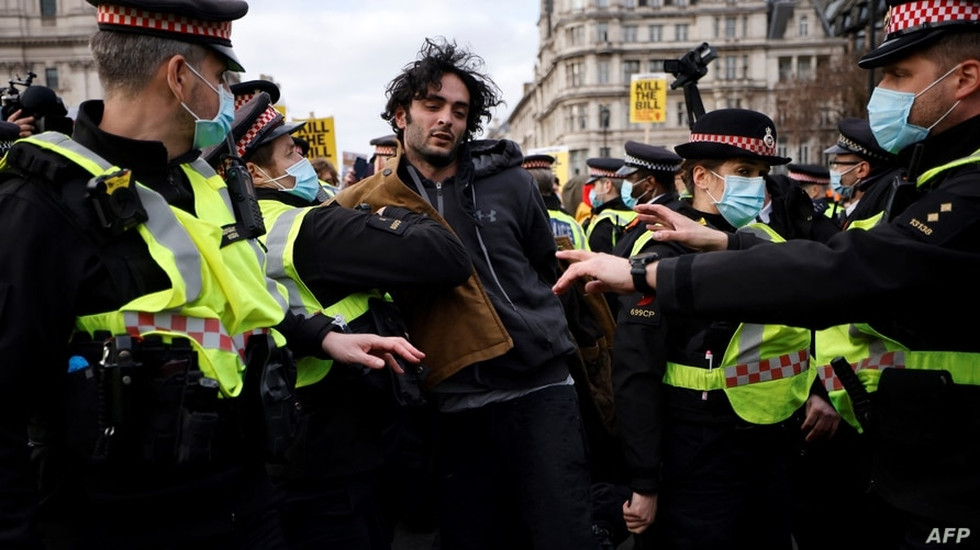 Police officers arrest a protestor during a 'Kill The Bill' protest against the Government's Police, Crime, Sentencing and…