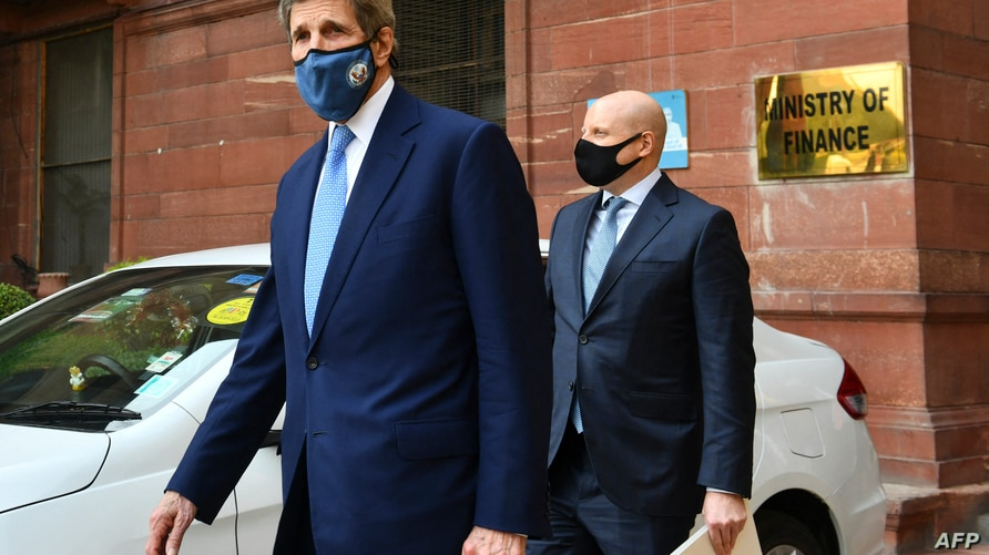US climate envoy John Kerry (L) leaves the Ministry of Finance after a meeting with Indian Finance Minister Nirmala Sitharaman,…