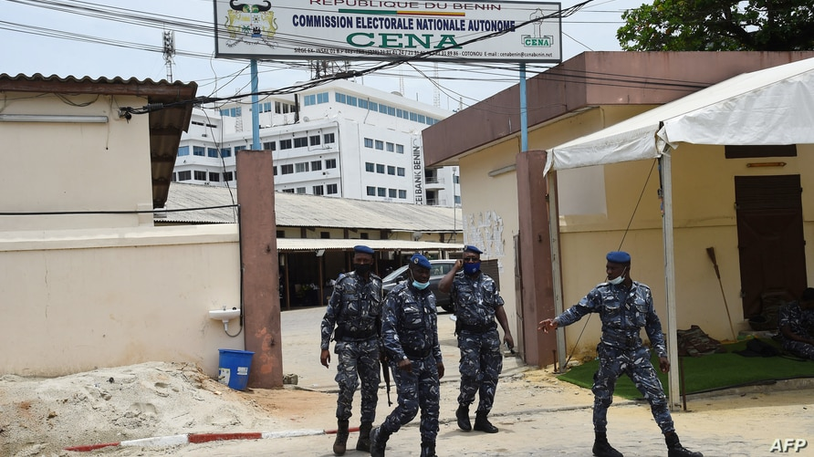 Police officers walk out of premises of the Autonomous National Electorial Commission (CENA) as counting of votes begins in…