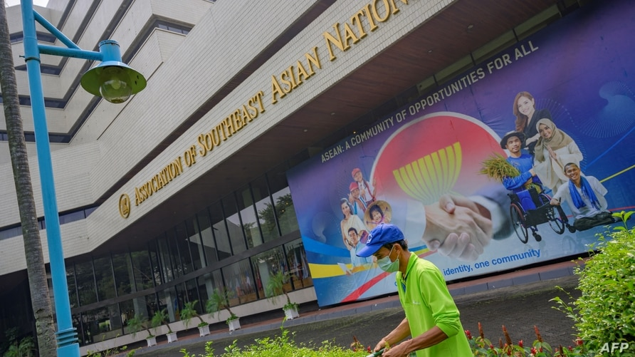 A gardener trims plants in the courtyard of the Association of Southeast Asian Nations (ASEAN) secretariat building in Jakarta…