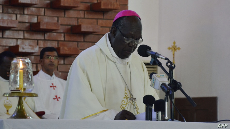 Archbishop Paulino Lukudu Loro leads a mass in Juba on December 15, 2014 to commemorate one year since the outbreak of the…