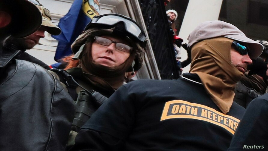 Members of the Oath Keepers militia group, including Jessica Marie Watkins (Left) who has since been indicted by federal…