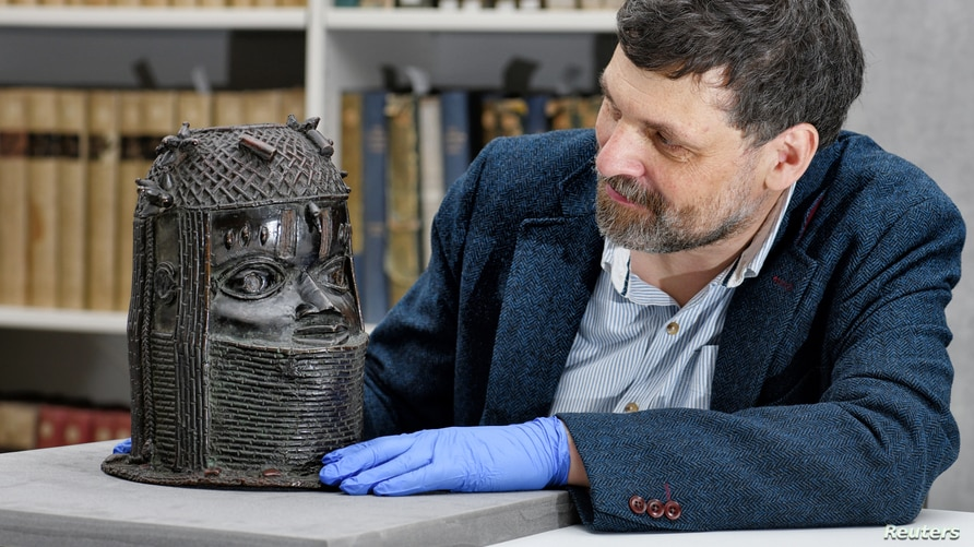 Neil Curtis, Head of Museums and Special collections is seen with one of the Benin bronze depicting the Oba of Benin at The Sir…