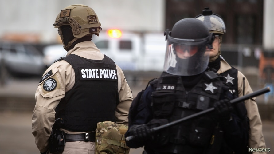 """Police are seen as Oregon State Police and the Salem Police Department declared an """"unlawful assembly"""" during an anti-fascist…"""
