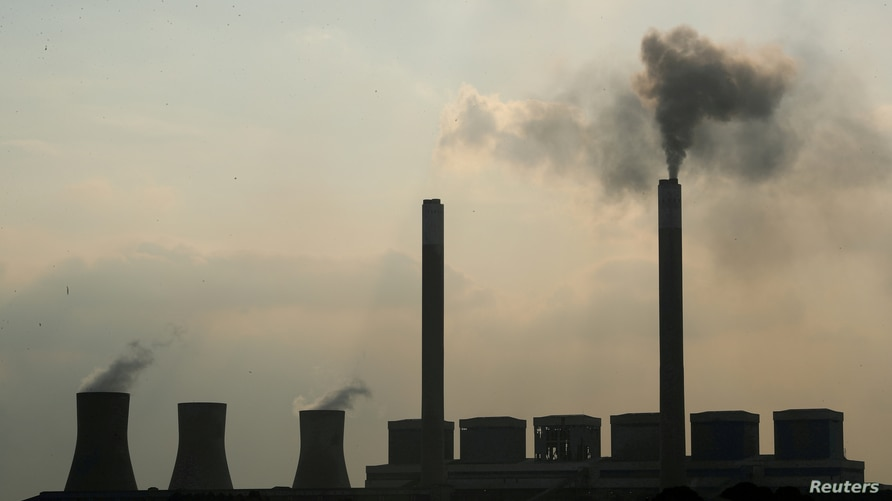 FILE PHOTO: Smoke rises from the Duvha coal-based power station owned by state power utility Eskom, in Mpumalanga province,…
