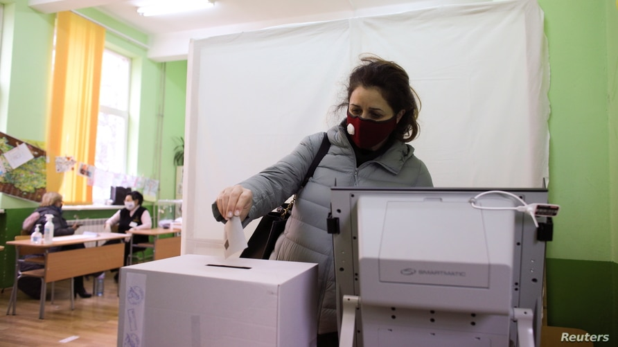 A woman votes in a polling station during parliamentary elections in Sofia, Bulgaria, April 4, 2021. REUTERS/Spasiyana Sergieva