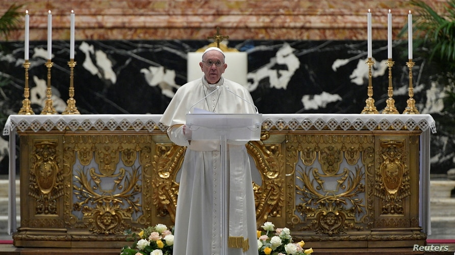 Pope Francis delivers his Urbi et Orbi blessing, after celebrating Easter Sunday Mass at St. Peter's Basilica at the Vatican…