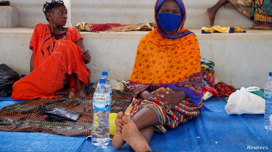 FILE - Displaced women sit on mats after fleeing an attack claimed by Islamic State-linked insurgents on the town of Palma, at a displacement centre in Pemba, Mozambique, April 2, 2021.
