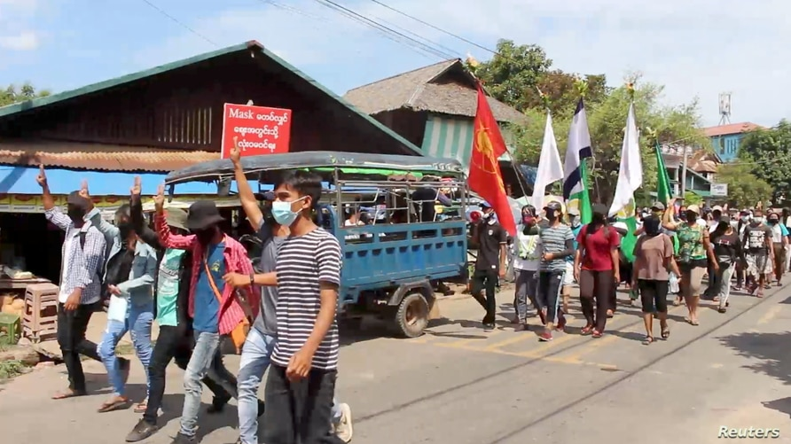 Demonstrators from the Dawei Technological University along with others march to protest against the military coup, in Dawei,…