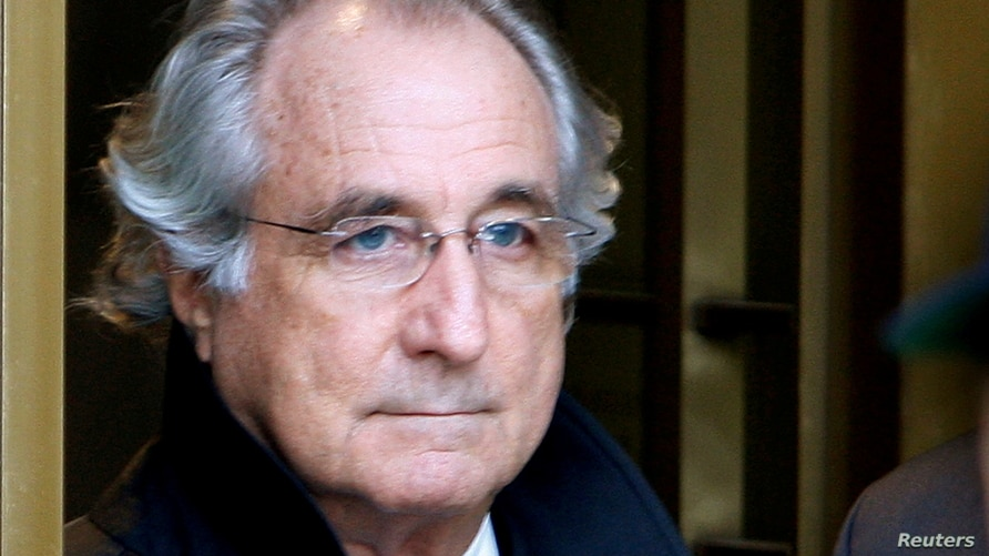 FILE PHOTO: Accused swindler Bernard Madoff exits the Manhattan federal court house in New York, U.S. on January 14, 2009…
