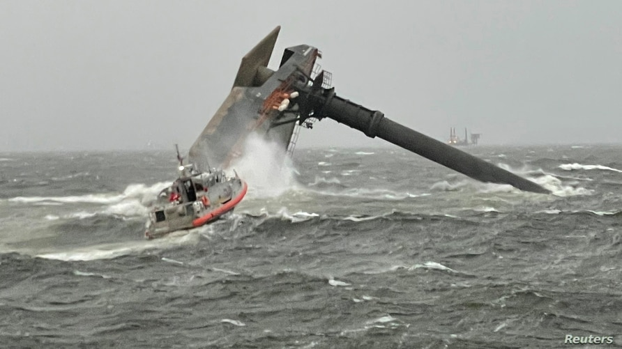 A Coast Guard Station Grand Isle boatcrew heads toward a capsized 175-foot commerical lift boat while searching for people in…
