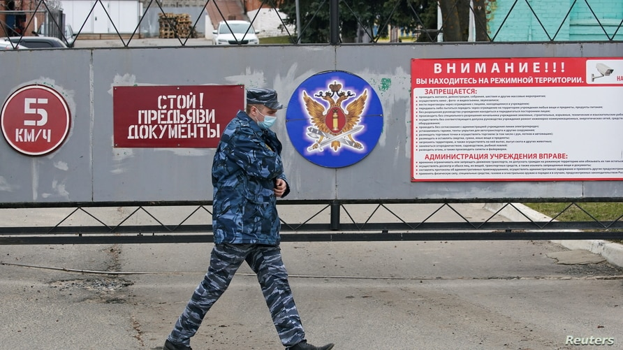 An officer walks outside the IK-3 penal colony, which houses a hospital where jailed Kremlin critic Alexei Navalny was…