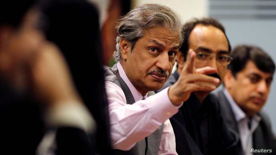 FILE - Absar Alam, then Chairman of the Pakistan Electronic Media Regulatory Authority (PEMRA), attends a planning meeting with senior staff in Islamabad, Pakistan, June 1, 2016.