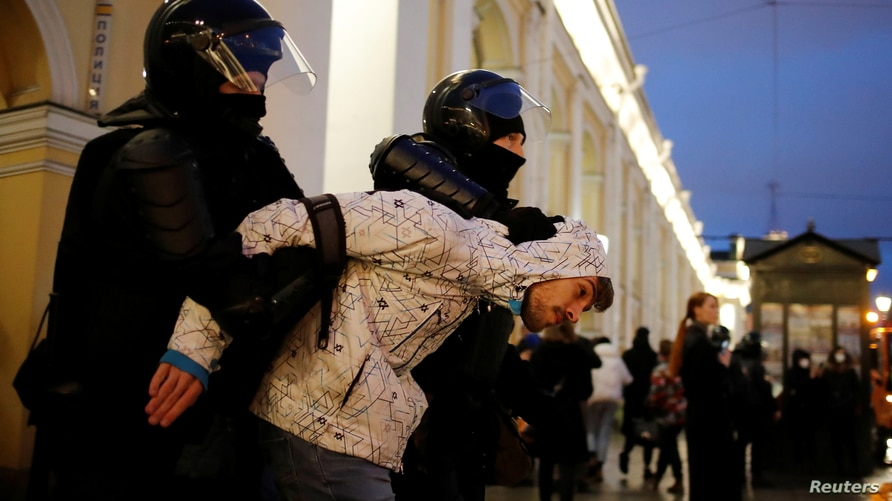 A demonstrator is taken away by law enforcement officers during a rally in support of jailed Russian opposition politician Alexei Navalny in Saint Petersburg, Russia April 21, 2021.