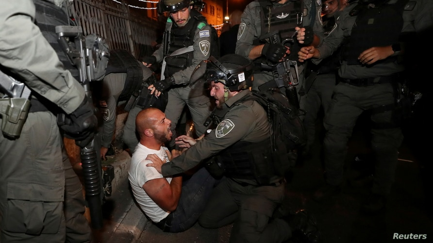 A Palestinian protester is detained during clashes with Israeli police, as the Muslim holy fasting month of Ramadan continues,…