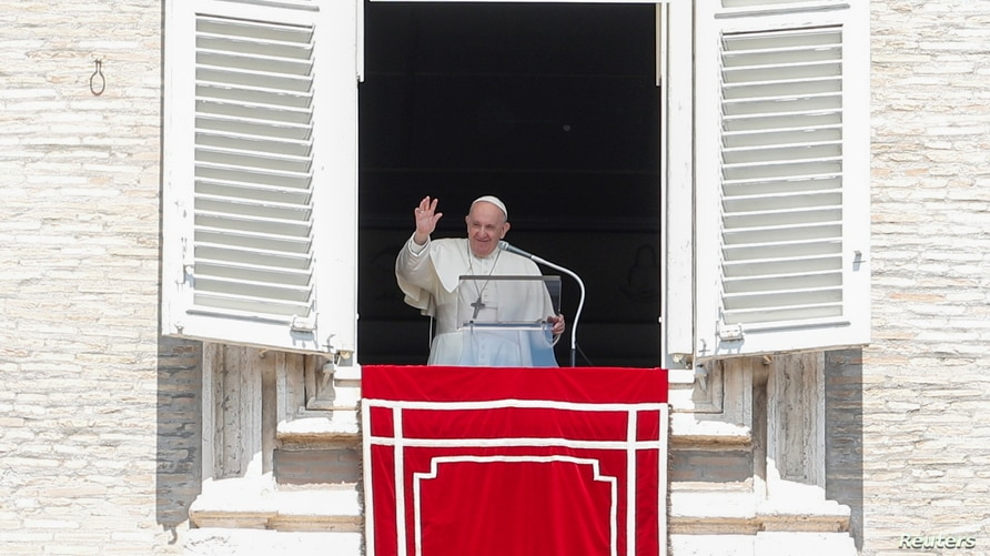 Pope Francis leads the Regina Coeli prayer from his window at St. Peter's Square at the Vatican, April 25, 2021. REUTERS/Remo…