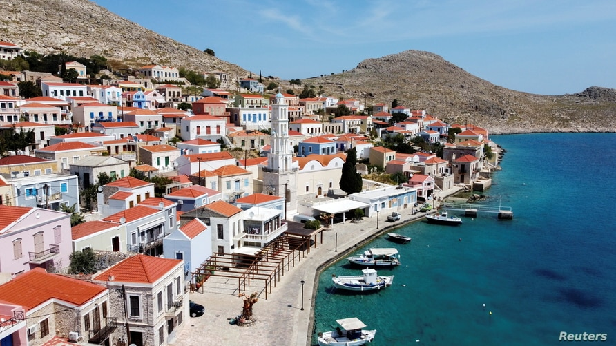 FILE PHOTO: View of the town of Halki, amid the coronavirus disease (COVID-19) pandemic, on the island of Halki, Greece, April…