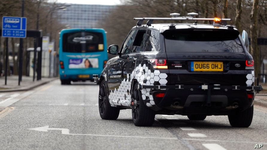 A Range Rover self driving car with its sensors drives with a safety driver onboard during a demonstration of connected and…