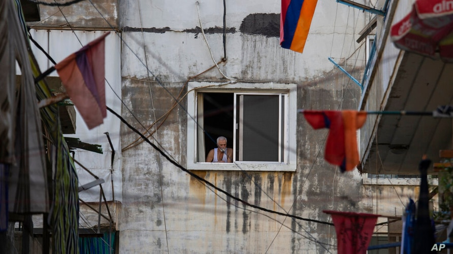 Armenian national flags hang from apartment balconies in the main Armenian district of the northern Beirut suburb of Bourj…