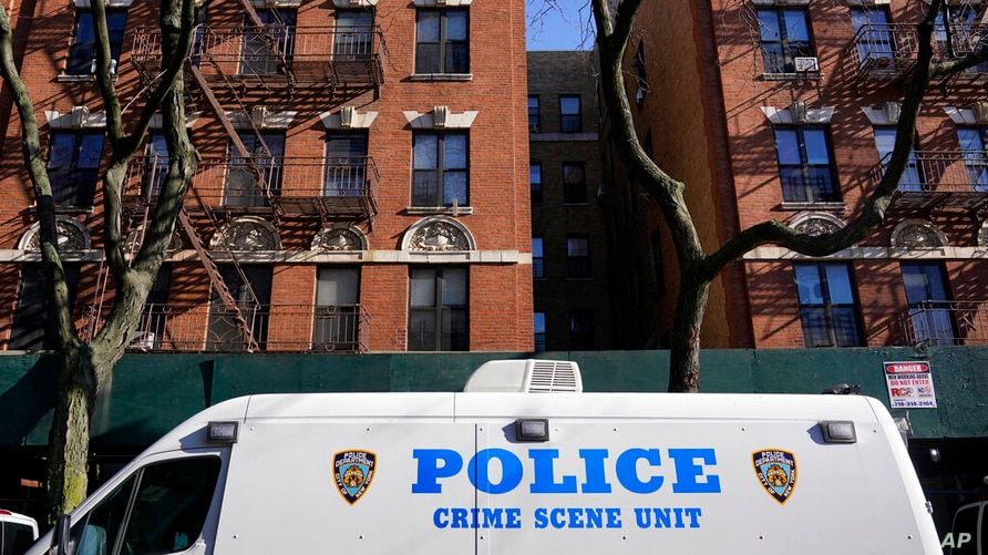 A crime scene unit vehicle is parked near the scene of a shooting in the Brooklyn borough of New York, Monday, Nov. 23, 2020…