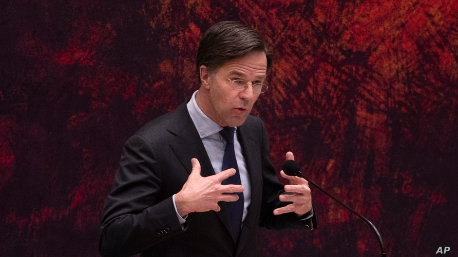 Caretaker Dutch Prime Minister Mark Rutte delivers a statement in parliament in The Hague, Netherlands, Friday, April 2, 2021…