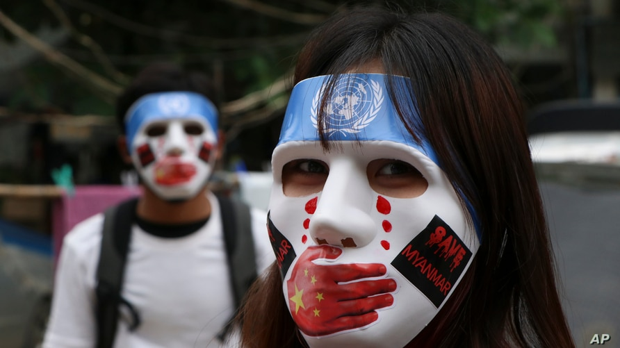 In this April 4, 2021, file photo, young demonstrators participate in an anti-coup mask strike in Yangon, Myanmar.